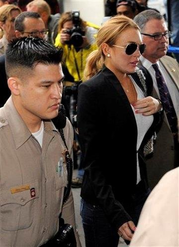Lindsay Lohan arrives for a probation violation hearing at Beverly Hills Courthouse in Beverly Hills, Calif., Friday, Oct. 22, 2010. (AP Photo/Chris Pizzello) By Chris Pizzello
