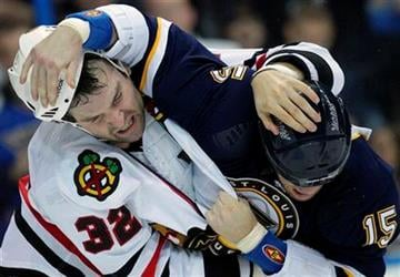 Chicago Blackhawks' John Scott, left, and St. Louis Blues' Brad Winchester fight during the second period of an NHL hockey game Friday, Oct. 22, 2010, in St. Louis. (AP Photo/Jeff Roberson) By Jeff Roberson