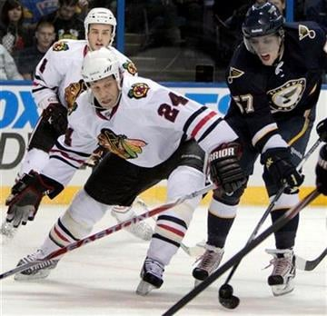 St. Louis Blues' David Perron, right, shoots and scores his second goal of the game past Chicago Blackhawks' Nick Boynton (24) during the second period of an NHL hockey game Friday, Oct. 22, 2010, in St. Louis. (AP Photo/Jeff Roberson) By Jeff Roberson