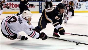 Chicago Blackhawks' Brent Seabrook, left, and St. Louis Blues' Alexander Steen reach for a loose puck during the second period of an NHL hockey game Friday, Oct. 22, 2010, in St. Louis. (AP Photo/Jeff Roberson) By Jeff Roberson