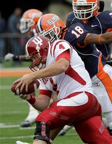 Indiana quarterback Ben Chappell (4) is sacked by Illinois linebacker Nate Bussey (18) during the first half of an NCAA college football game in Champaign, Ill., Saturday, Oct. 23, 2010. (AP Photo/Seth Perlman) By Seth Perlman