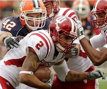Indiana wide receiver Tandon Doss (2) runs past Illinois linebacker Aaron Gress (42) during the first half of an NCAA college football game in Champaign, Ill., Saturday, Oct. 23, 2010. (AP Photo/Seth Perlman) By Seth Perlman