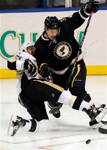 St. Louis Blues' Erik Johnson, right, battles for the puck with Pittsburgh Penguins' Maxime Talbot, left,in the third period of an NHL hockey game Saturday Oct. 23, 2010 in St. Louis. The Blues won in overtime 1-0. (AP Photo/Bill Boyce) By Bill Boyce
