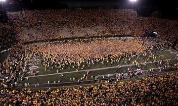 Fans storm the field following Missouri's 36-27 victory over Oklahoma in an NCAA college football game Saturday, Oct. 23, 2010, in Columbia, Mo. (AP Photo/Jeff Roberson) By Jeff Roberson