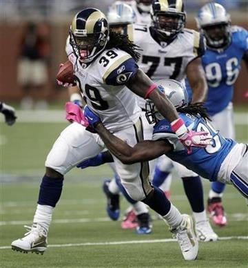 St. Louis Rams running back Steven Jackson (39) breaks a Detroit Lions tackle in the second quarter of an NFL football game in Detroit, Sunday, Oct. 10, 2010. (AP Photo/Paul Sancya) By Paul Sancya