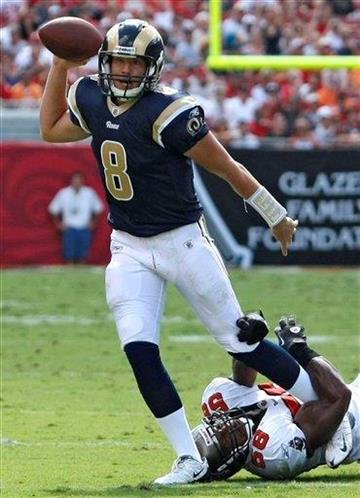 St. Louis Rams quarterback Sam Bradford (8) eludes a tackle by Tampa Bay Buccaneers linebacker Quincy Black (58) during the first half of an NFL football game, Sunday, Oct. 24, 2010, in Tampa, Fla. (AP Photo/Chris O'Meara) By Chris O'Meara