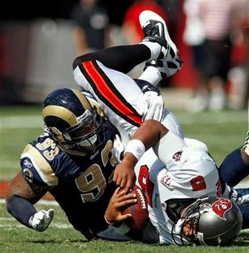 St. Louis Rams defensive tackle Jermelle Cudjo (93) sacks Tampa Bay Buccaneers quarterback Josh Freeman (5) during the first quarter of an NFL football game Sunday, Oct. 24, 2010, in Tampa, Fla. (AP Photo/Brian Blanco) By Brian Blanco