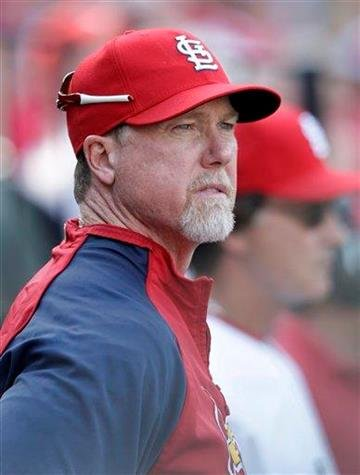 St. Louis Cardinals batting coach Mark McGwire watches the action in the sixth inning of a baseball game against the Houston Astros, Monday, April 12, 2010 in St. Louis. (AP Photo/Tom Gannam) By Tom Gannam