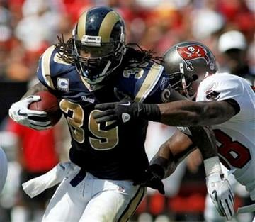 St. Louis Rams running back Steven Jackson (39) breaks a first half tackle by Tampa Bay Buccaneers linebacker Quincy Black (58) during an NFL football game, Sunday, Oct. 24, 2010, in Tampa, Fla. (AP Photo/Brian Blanco) By Brian Blanco