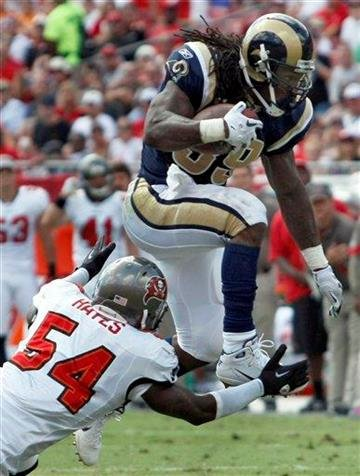 St. Louis Rams running back Steven Jackson (39) leaps over a tackle by Tampa Bay Buccaneers linebacker Geno Hayes (54) during the second quarter of an NFL football game, Sunday, Oct. 24, 2010, in Tampa, Fla. (AP Photo/Chris O'Meara) By Chris O'Meara
