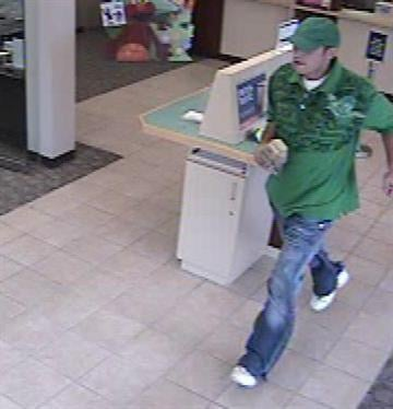 Surveillance photos show a suspect in a robbery at PNC Bank in Des Peres on Monday, October 25, 2010. By KMOV Web Producer