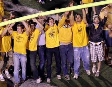 Missouri fans celebrate by tearing down a goal post following the Tigers' 36-27 victory over Oklahoma in an NCAA college football game Saturday, Oct. 23, 2010, in Columbia, Mo. (AP Photo/Jeff Roberson) By Jeff Roberson