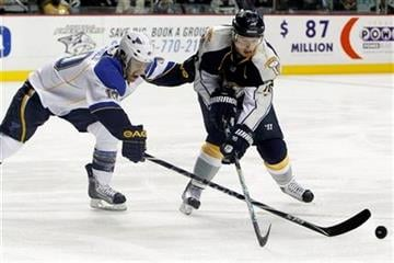 St. Louis Blues center Andy McDonald (10) pokes the puck away from Nashville Predators center Cal O'Reilly (16) in the first period of an NHL hockey game Thursday, Oct. 28, 2010, in Nashville, Tenn. (AP Photo/Mark Humphrey) By Mark Humphrey