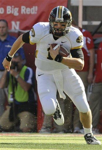 Missouri quarterback Blaine Gabbert (11) scrambles in the first half of an NCAA college football game against Nebraska, in Lincoln, Neb., Saturday, Oct. 30, 2010. (AP Photo/Dave Weaver) By Dave Weaver