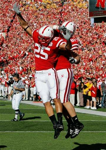 Nebraska tight end Kyler Reed (25) and Nebraska tight end Ben Cotton (81) celebrate Reed's touchdown against Missouri in the first half of an NCAA college football game in Lincoln, Neb., Saturday, Oct. 30, 2010. (AP Photo/Nati Harnik) By Nati Harnik