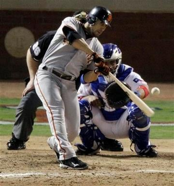 San Francisco Giants' Andres Torres hits a solo home run during the eighth inning of Game 3 of baseball's World Series against the Texas Rangers Saturday, Oct. 30, 2010, in Arlington, Texas. (AP Photo/Eric Gay) By Eric Gay