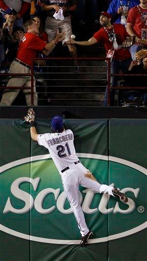 Texas Rangers' Jeff Francoeur can't come up with a ball hit by San Francisco Giants' Andres Torres during the eighth inning of Game 3 of baseball's World Series Saturday, Oct. 30, 2010, in Arlington, Texas. (AP Photo/Matt Slocum) By Matt Slocum
