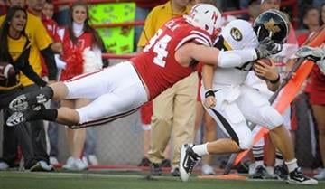 Nebraska's Jared Crick (94) takes down Missouri's Blaine Gabbert (11) during an NCAA college football game Saturday Oct 30, 2010, in Lincoln, Neb.(AP Photo/Dave Weaver) By Dave Weaver