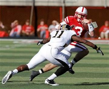 Nebraska quarterback Taylor Martinez (3) is tackled by Missouri safety Jarrell Harrison (11) during the first half of an NCAA college football game in Lincoln, Neb., Saturday, Oct. 30, 2010. (AP Photo/Nati Harnik) By Nati Harnik