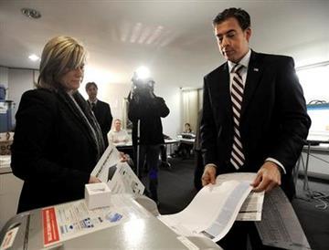 Democratic U.S. Senate candidate Alexi Giannoulias votes at the Cedar St. Condominium Association in Chicago, Tuesday Nov. 2, 2010. (AP Photo/Paul Beaty) By Paul Beaty