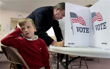 Missouri Republican U.S. Senate candidate Roy Blunt votes as his 5-year-old son Charlie waits by his side Tuesday, Nov. 2, 2010, in Springfield, Mo. (AP Photo/Jeff Roberson) By Jeff Roberson