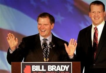 Illinois Republican gubernatorial candidate Bill Brady, left, waves to supporters in Bloomington, Ill., Wednesday, Nov. 3, 2010, while Lt. Governor candidate Jason Plummer looks on.  (AP Photo/Seth Perlman) By Seth Perlman