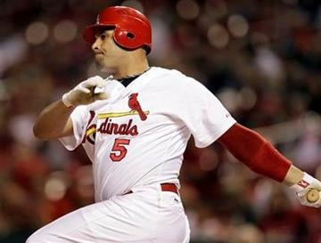 St. Louis Cardinals first baseman Albert Pujols follows through on an RBI double during the first inning of a baseball game against the Colorado Rockies on Thursday, Sept. 30, 2010, in St. Louis. (AP Photo/Jeff Roberson) By Jeff Roberson