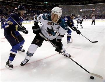 San Jose Sharks' Ryane Clowe, right, looks to pass the puck in the corner as St. Louis Blues' Brad Boyes defends during the first period of an NHL hockey game Thursday, Nov. 4, 2010, in St. Louis. (AP Photo/Jeff Roberson) By Jeff Roberson