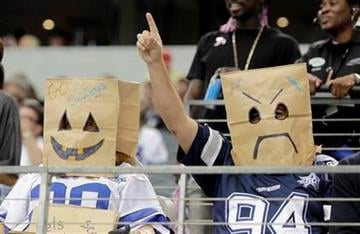 Dallas Cowboys fans wear paper bags over their heads before an NFL football game against the Jacksonville Jaguars in Arlington, Texas, Sunday, Oct. 31, 2010. (AP Photo/Sharon Ellman) By Sharon Ellman