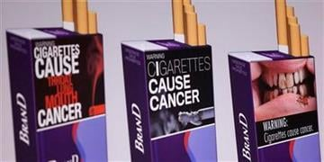 Three examples of proposed warning graphics that will appear on cigarette packaging as part of the government's new tobacco prevention efforts, seen in Washington, Wednesday, Nov. 10, 2010.   (AP Photo/Evan Vucci) By Evan Vucci