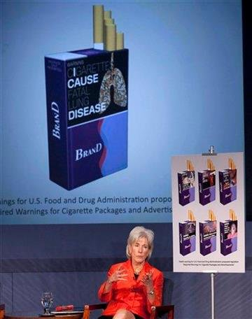 Health and Human Services Secretary Kathleen Sebelius gestures during a news conference in Washington, Wednesday, Nov. 10, 2010, to release proposed warning graphics that will appear on cigarette packaging.   (AP Photo/Evan Vucci) By Evan Vucci