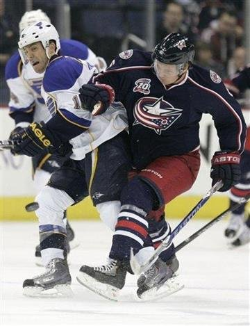 Columbus Blue Jackets' Anton Stralman, right, of Sweden, and  St Louis Blues' Andy McDonald work for the puck in the first period of an NHL hockey game in Columbus, Ohio, Wednesday, Nov. 10, 2010. (AP Photo/Paul Vernon) By Paul Vernon