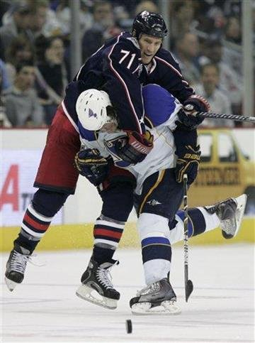 Columbus Blue Jackets' Chris Clark, top, gets tangled with St Louis Blues' TJ Oshie in the second period of an NHL hockey game in Columbus, Ohio, Wednesday, Nov. 10, 2010. (AP Photo/Paul Vernon) By Paul Vernon