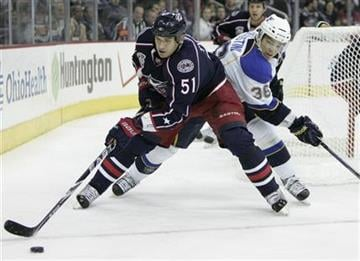 Columbus Blue Jackets' Fedor Tyutin, left, of Russia, controls the puck in front of St Louis Blues' Matt D'Agostini in the first period of an NHL hockey game in Columbus, Ohio, Wednesday, Nov. 10, 2010. (AP Photo/Paul Vernon) By Paul Vernon