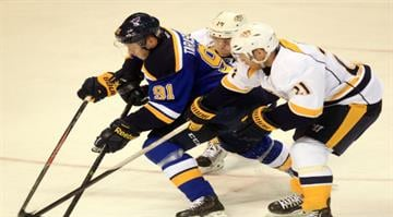 St. Louis Blues Vladimir Tarasenko is double teamed by Nashville Predators Mattias Ekholm of Sweden and Derek Roy as he moves up the ice in the first period at the Scottrade Center in St. Louis on November 8, 2014. UPI/Bil Greenblatt By Bil Greenblatt