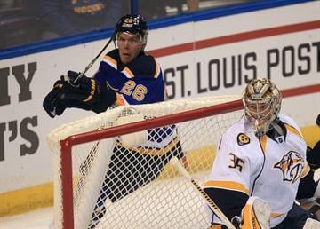 St. Louis Blues Paul Stastny tries to knock down an airborne puck as Nashville Predators goaltender Pekka Rinne of Finland looks for it during the first period at the Scottrade Center in St. Louis on November 8, 2014. UPI/Bil Greenblatt By BILL GREENBLATT