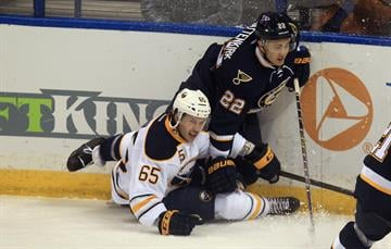 St. Louis Blues Kevin Shattenkirk falls over Buffalo Sabres Brian Flynn during first period action at the Scottrade Center in St. Louis on November 11, 2014. UPI/Bill Greenblatt By BILL GREENBLATT