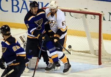 St. Louis Blues Barret Jackman (5) attempts to clear the crease of Nashville Predators Mike Ribeiro in the first period at the Scottrade Center in St. Louis on November 13, 2014. UPI/Bill Greenblatt By BILL GREENBLATT