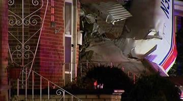 A small cargo plane crashed into a home near Chicago's Midway Airport around 3 a.m. Tuesday morning, Nov. 18, 2014. Two elderly residents escaped the home uninjured. Firefighters have not been able to locate the pilot. By n/a