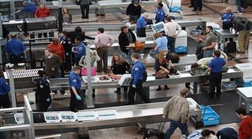Travelers at Denver International Airport line up before a TSA checkpoint. Despite heavy volume due to Thanksgiving week travel and concerns over TSA security measures there were few delays. By Stephanie Baumer