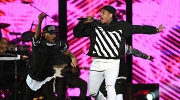 LAS VEGAS, NV - NOVEMBER 07:  Recording artist Chris Brown (R) performs during the 2014 Soul Train Music Awards at the Orleans Arena on November 7, 2014 in Las Vegas, Nevada.  (Photo by Ethan Miller/BET/Getty Images for BET) By Ethan Miller/BET