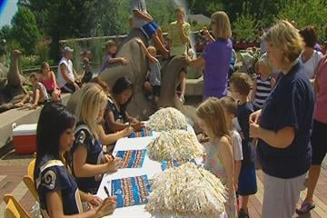 St. Louis Rams cheerleaders sign autographs during the Rams' new mascot debut ceremony at the St. Louis Zoo on Monday, July 26, 2010.