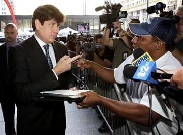 Former Illinois Gov. Rod Blagojevich talks with Darrell Murphy as he arrives at the Federal Court building for closing arguments in his federal corruption trial Tuesday, July 27, 2010 in Chicago.  (AP Photo/Charles Rex Arbogast) By Charles Rex Arbogast