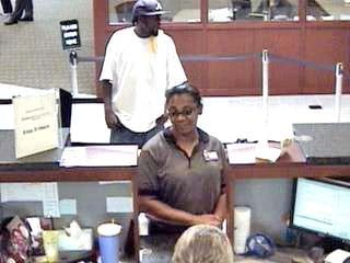 The FBI are looking for this man (background), who is accused of robbing the Commerce Bank in Florissant on July 28, 2010. By KMOV Web Producer