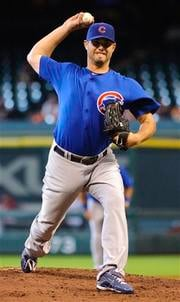 Chicago Cubs' Randy Wells delivers a pitch during the first inning of an MLB baseball game against the Houston Astros, Wednesday, July 28, 2010, in Houston. (AP Photo/Dave Einsel) By Dave Einsel