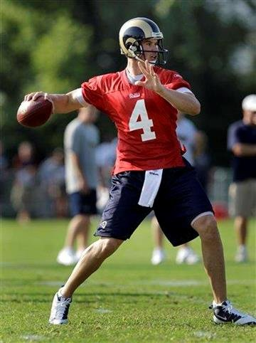 St. Louis Rams quarterback A.J. Feeley drops back to pass during NFL football training camp at the team's training facility Thursday, July 29, 2010, in St. Louis. (AP Photo/Jeff Roberson) By Jeff Roberson