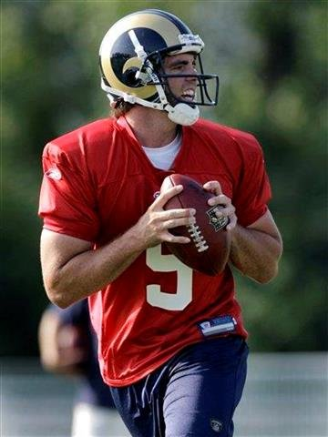 St. Louis Rams quarterback Keith Null drops back to pass during NFL football training camp at the team's training facility Thursday, July 29, 2010, in St. Louis. (AP Photo/Jeff Roberson) By Jeff Roberson