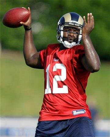 St. Louis Rams quarterback Thaddeus Lewis throws during NFL football training camp at the team's training facility Thursday, July 29, 2010, in St. Louis. (AP Photo/Jeff Roberson) By Jeff Roberson