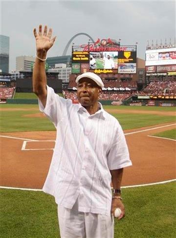 St. Louis Cardinals Hall-of-Famer Ozzie Smith waves to fans before throwing out a ceremonial first pitch before a baseball game between the Pittsburgh Pirates and the Cardinals, Friday, July 30, 2010, in St. Louis.(AP Photo/Tom Gannam) By Tom Gannam