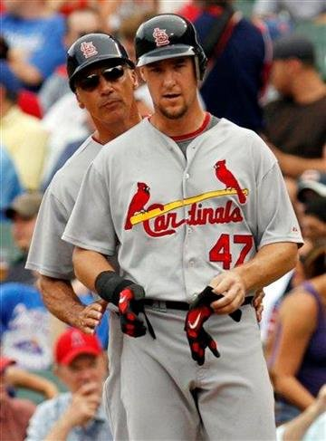 St. Louis Cardinals first base coach Dave McKay, left, talks to Ryan Ludwick during the second inning of a baseball game against the Chicago Cubs Saturday, July 24, 2010, in Chicago.(AP Photo/Nam Y. Huh) By Nam Y. Huh
